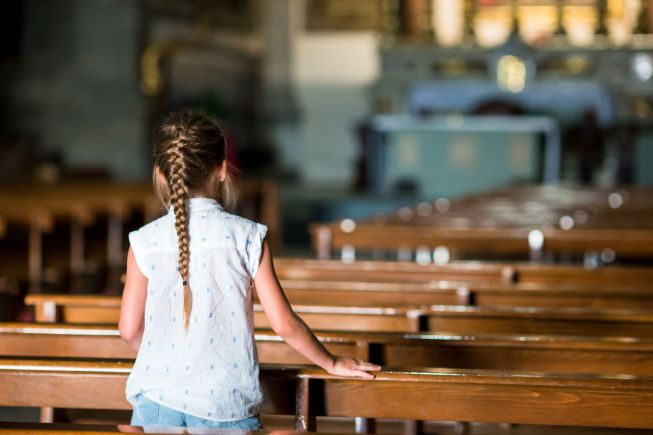 68460441 - child in beautiful old church in small european city